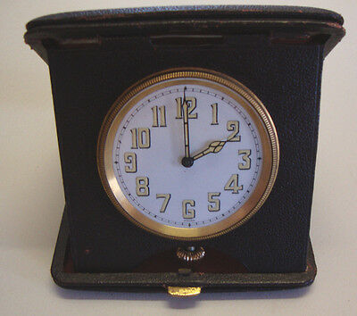 Antique leather cased traveling clock swiss made