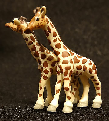 Tiny Pair of Giraffes ornament approx. 1 5/8 inches tall
