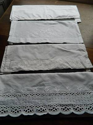 Four vintage white cotton pillowcases with whitework embroidery and/or lace trim