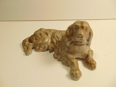 Older cast white metal reclining dog figure - about 5 3/8th inches long