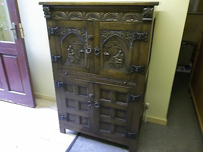 Carved Oak drinking cabinet
