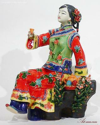 Porcelain figurine Chinese oriental lady enjoying tea