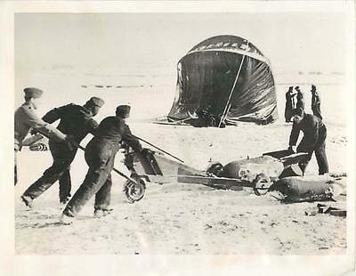 WWII Ground Crew Hauling Bombs across Snow-Covered German Airfield Press Photo