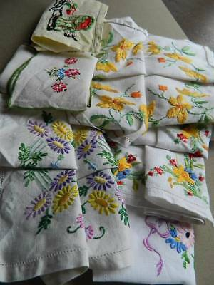 Collection of 7 vintage hand embroidered table toppers or tray cloths.