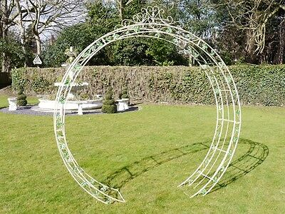 Ornate Metal Round Vintage Garden Arch With Green And White Flower Decoration