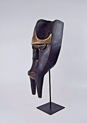 A Bold & Powerful Kwele Mountain Gorilla mask on display stand, African mask
