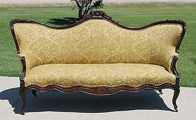 Early Victorian Carved Rosewood Sofa with Carved Roses Circa 1865