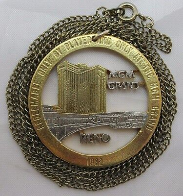 MGM GRAND HOTEL RENO NEVADA TOKEN Turned into necklace pendant on chain 1982
