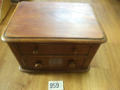 Tiny antique chest of drawers