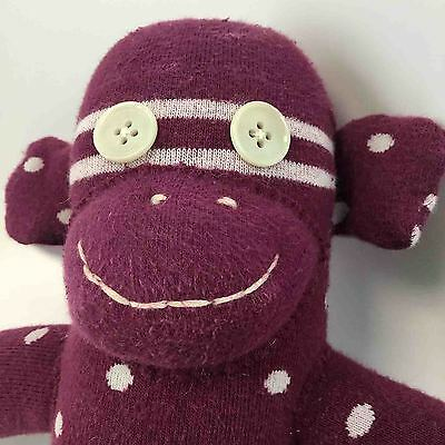 Violet the plum colored sock monkey