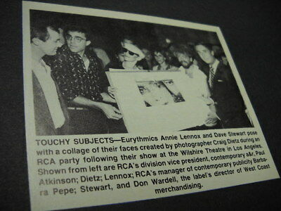 EURTHMICS pose with their own faces 1984 music biz promo pic with text