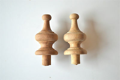 A pair of 2 1/4 inch antique hardwood turned finial furniture clock F13