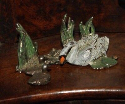 Vintage miniature cold painted Swan and Ducks with lily pads.