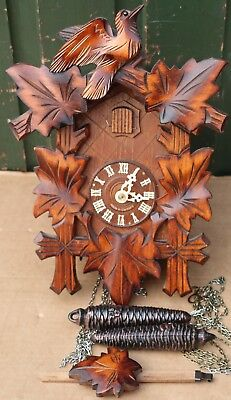 Lovely Looking Wooden Weight Driven Cuckoo Clock In Working Order