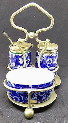 An antique china cruet set with a Charles Hattersley nickel silver holder