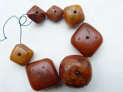 7  Antique carved phenolic resin beads. African Trade. Mauritania, African Amber