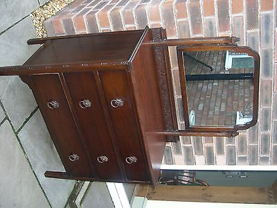 A 1940's three drawer mahogany chest of three drawers with mirror.