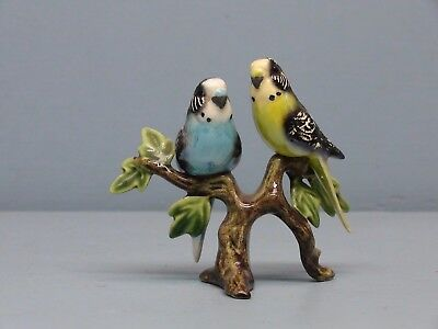 Retired Hagen Renaker Specialty Parakeets on Glossy Branch