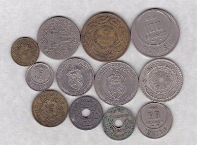 12 Coins From Tunisia Dated From 1919 To 1997 In Good Fine Or Better Condition