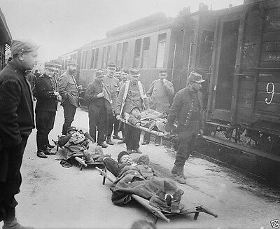Wounded French soldiers being loaded on railroad cars World War I 8x10 Photo