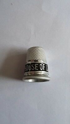 Old Aluminium advertising thimble. Drink House of Lords Tea