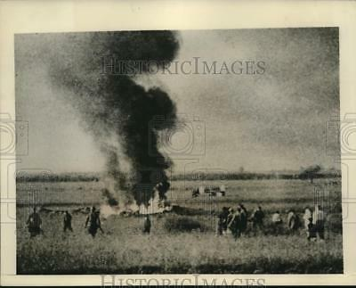 1941 Photo Soviet soldiers and farmers watch as German plane burns WWII