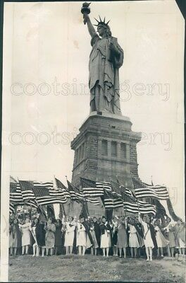 1947 Press Photo Patriotic Women Wave American Flags Foot of Statue of Liberty