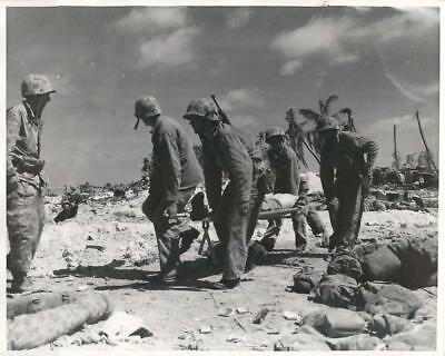 WWII U.S. Marines Carry Wounded Buddy to Dressing Station on Tarawa Press Photo