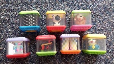 9 rigid plastic baby play cubes
