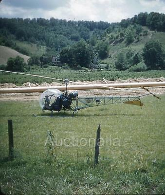 205M Original Stereo Slide Bell helicopter In Field Price Sign 1950's