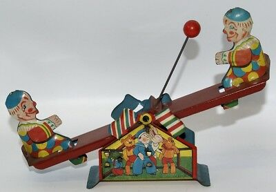 Vintage 1930's Tin Lithographed Windup Clowns Playing on Teeter-Totter with Ball