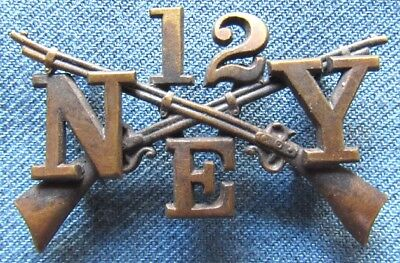 NYNG collar insignia for Company E, 12th Infantry Regiment, with loop fasteners