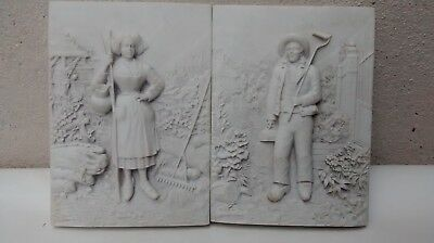 Pair of pottery Russian plaques-farmer and his wife,stamped St Petersburg,good c