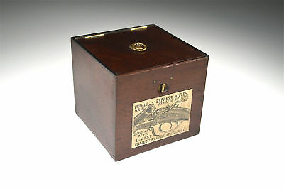 Small antique mahogany hinge top box with interesting paper label
