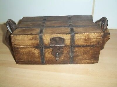 vintage wooden box with horseheads on ends