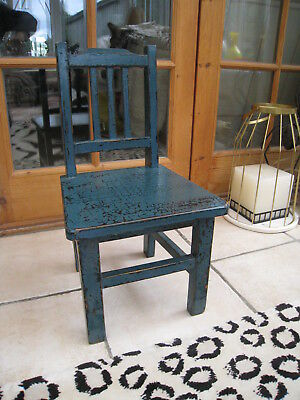 Small old wooden child's teddy's doll's chair with distressed paint effect.