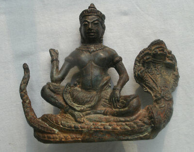 Ancient Buddha statue sitting on a Naga from Cambodia