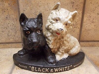 Cast Iron Black & White Whiskey Scottish Terrier Dog Doorstop Advertisement