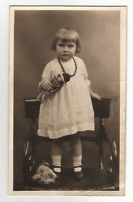 bn children postcard real photograph girl and her toy doll