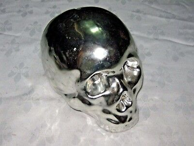 A Chrome Ceramic Skull Novelty Moneybox with Base Plug