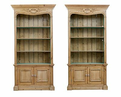 PAIR OF 1920's CARVED PINE BOOKCASES