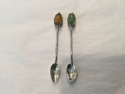 Set of two .800 silver salt spoons with gourd shaped caged stone finials