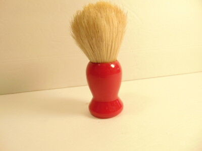 vintage shaving brush with a bright red plastic handle