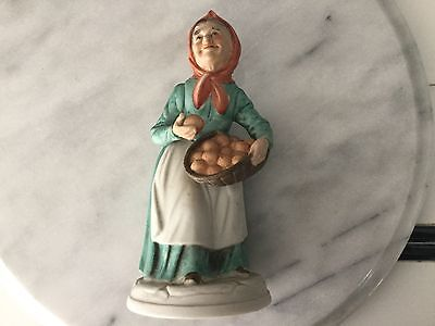 Napco figurine of old woman with basket of oranges C8357