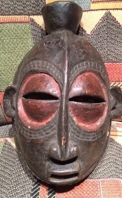 ANTIQUE  Hand-Carved Wooden AFRICAN MASK - black w/ red eyes Very Good condition