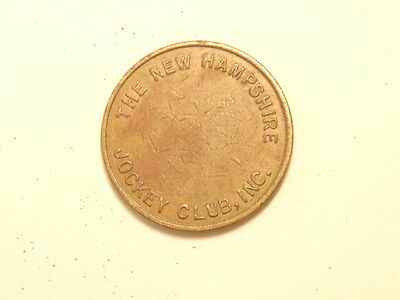 old brass colored token: The New Hampshire Jockey Club; rev. Rockingham Park