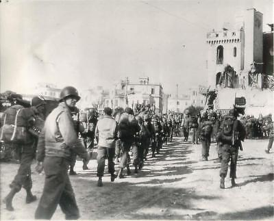 WWII U.S. Soldiers of Invasion Force March along Street in Anzio Press Photo