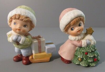 "Pair of Homco ""Girl Hugging Tree"" and ""Boy Pulling Sled of Gifts"" Figurines"