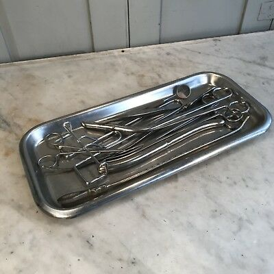 Set vintage misc surgical instruments on metal tray