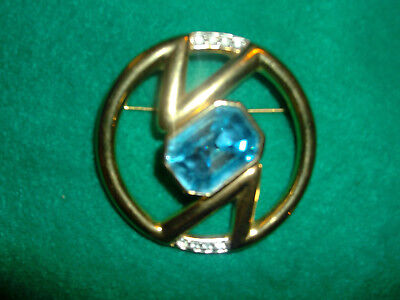 Vintage Signed COURREGES PARIS Pin with Blue Stone in Center .
